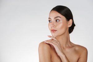 beauty Azerbaijani young woman touching her nude shoulder